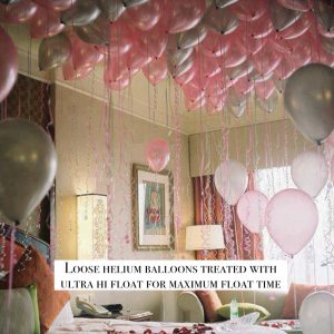 Loose helium balloons pink white and silver